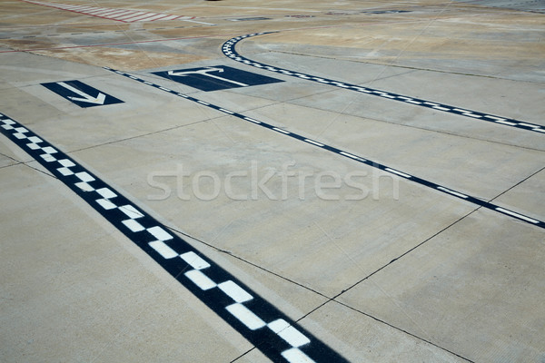 Stock photo: Airport road floor signs painted