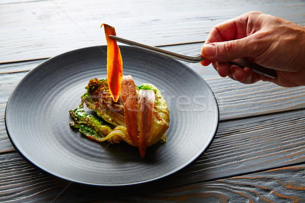 Cantabrian anchovies with endive chef hand Stock photo © lunamarina
