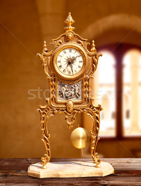 ancient vintage golden brass pendulum clock Stock photo © lunamarina