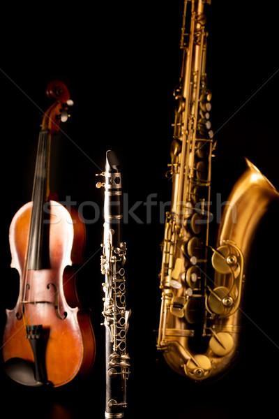 Muzyki saksofon skrzypce czarny tle Zdjęcia stock © lunamarina
