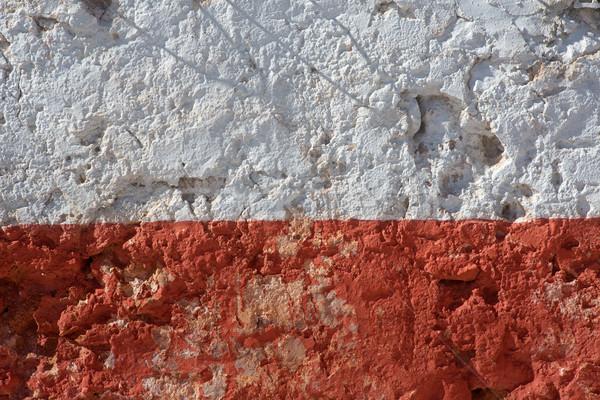 Aged whitewashed wall with red grunge paint Stock photo © lunamarina