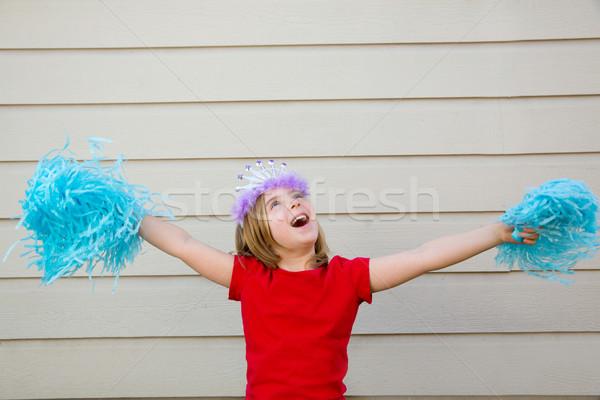 Blond kid girl playing like cheerleading pom poms and crown Stock photo © lunamarina