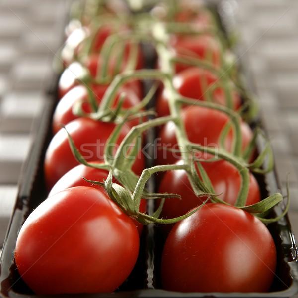 Rosso pomodori ramo onu nero plastica Foto d'archivio © lunamarina