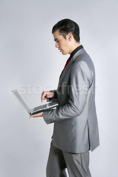 Stock fotó: üzletember · szürke · öltöny · tart · laptop · laptop · számítógép