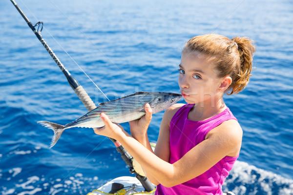 Сток-фото: Kid · девушки · рыбалки · тунца · целоваться · рыбы