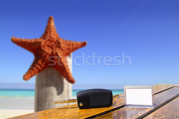 Car rental keys on wood table in vacation with starfish Stock photo © lunamarina