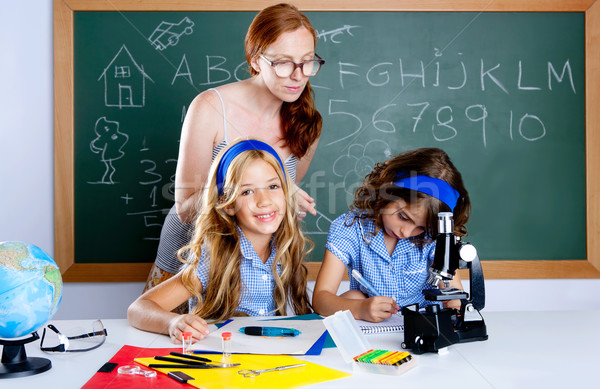 kids students with nerd teacher woman at school Stock photo © lunamarina