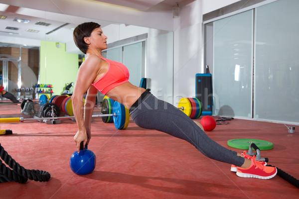 Crossfit fitness woman push ups kettlebell pushup exercise Stock photo © lunamarina