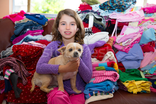 girl sitting on a messy clothes sofa with chihuahua dog Stock photo © lunamarina