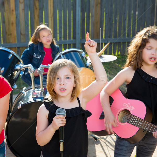 chidren singer girl singing playing live band in backyard Stock photo © lunamarina