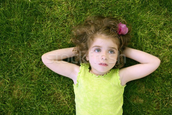 Beautiful little toddler girl happy lying on grass Stock photo © lunamarina