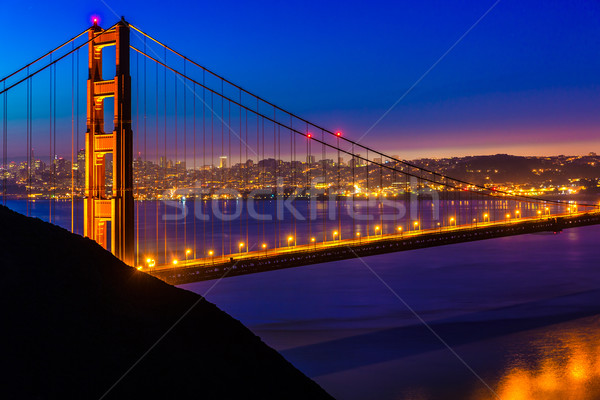 San Francisco Golden Gate Bridge sunset through cables Stock photo © lunamarina