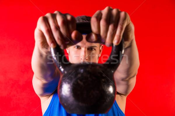 Kettlebell man portrait looking through the handle Stock photo © lunamarina