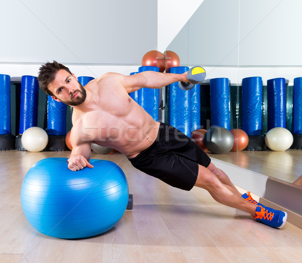 Fitball abdominal side push ups Swiss ball man Stock photo © lunamarina
