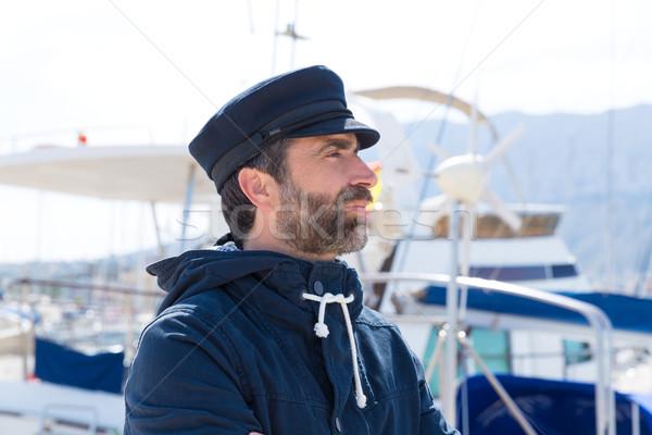 Sailor in marina port with boats background Stock photo © lunamarina