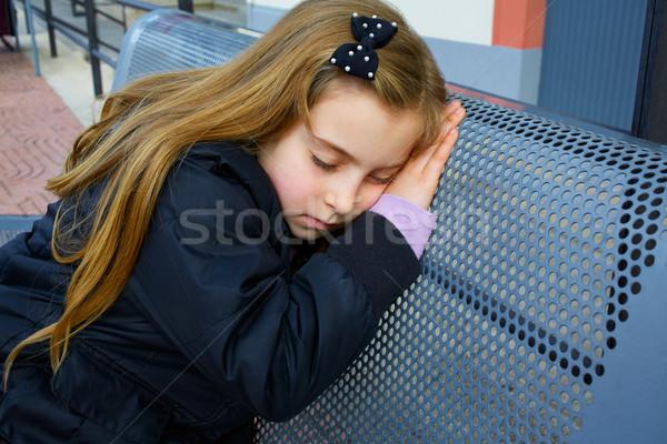 Blond kid girl pretending being sleep on bench Stock photo © lunamarina