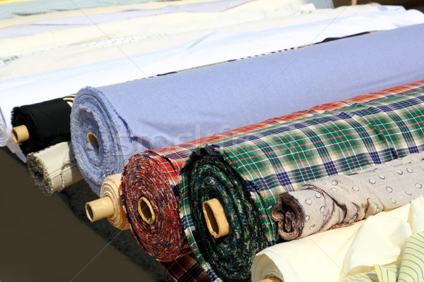 Colorful fabric rolls row in market shop Stock photo © lunamarina