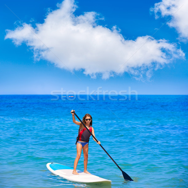 Stock photo: Kid paddle surf surfer girl with row in the beach