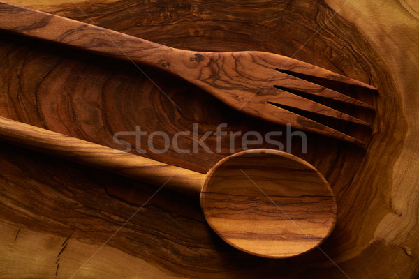 Olive wood spoon and fork on cutting board Stock photo © lunamarina