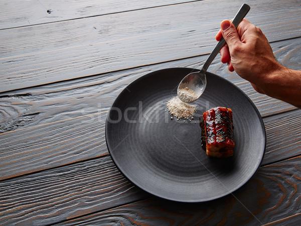 Alla griglia affumicato anguilla nero piatto verde Foto d'archivio © lunamarina
