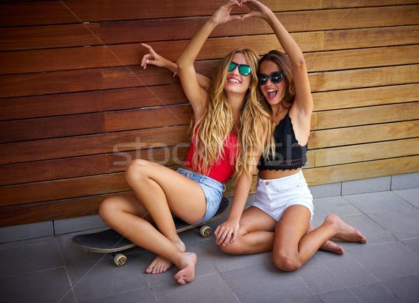 Best friends teen girls on skate having fun Stock photo © lunamarina
