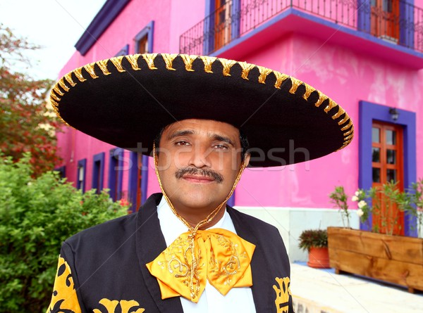 Charro mexican Mariachi portrait in pink house Stock photo © lunamarina