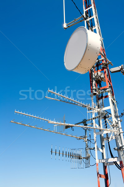 Antenna repeater messy mast in blue sky Stock photo © lunamarina