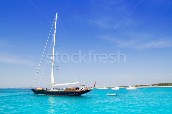 anchored sailboats in turquoise Formentera beach Stock photo © lunamarina