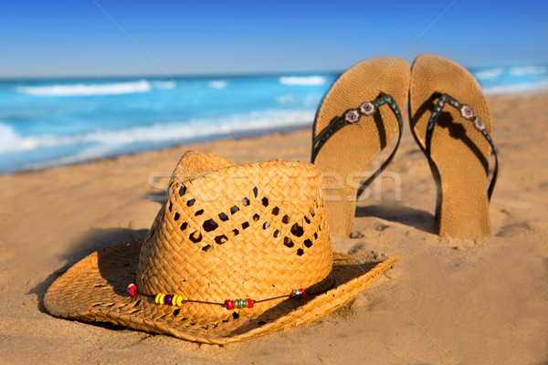 golden sand beach with summer hat and sandals Stock photo © lunamarina