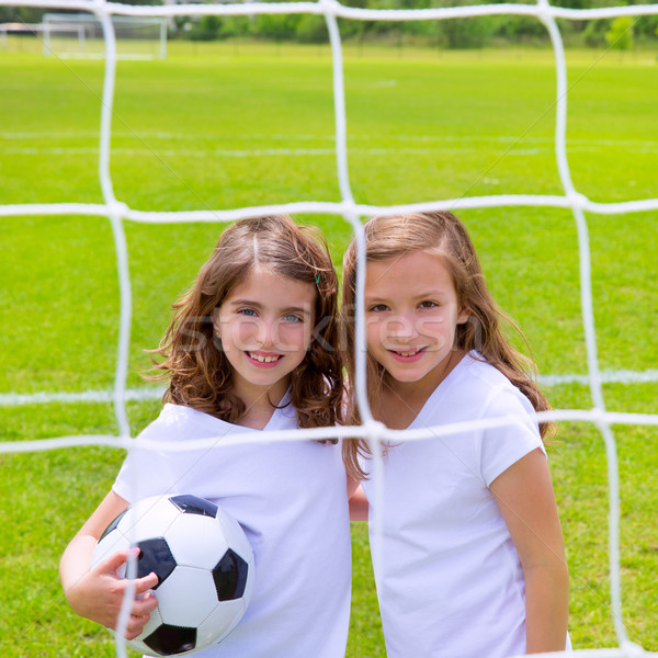 Soccer football kid girls playing on field Stock photo © lunamarina