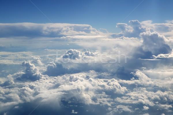 Blauwe hemel vliegtuigen vliegtuig witte wolken Stockfoto © lunamarina