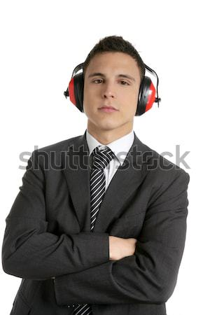 Young businessman protecting from noise Stock photo © lunamarina