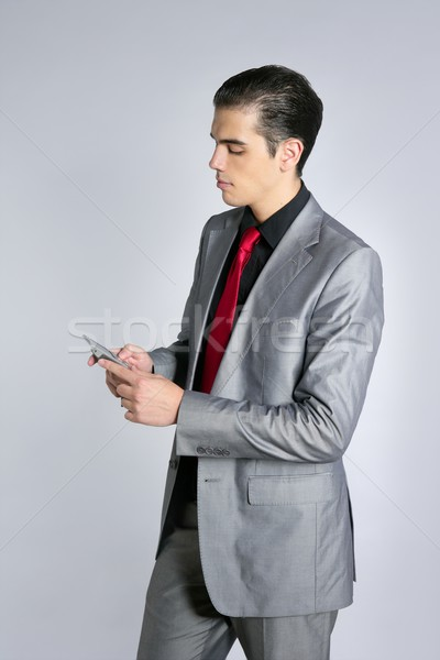 Businessman with gray suit talking cellular Stock photo © lunamarina