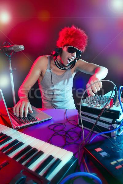 Dj with colorful light and music mixing equipment Stock photo © lunamarina