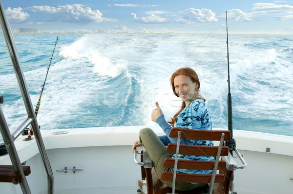 fisherwoman big game on boat chair ok sign Stock photo © lunamarina