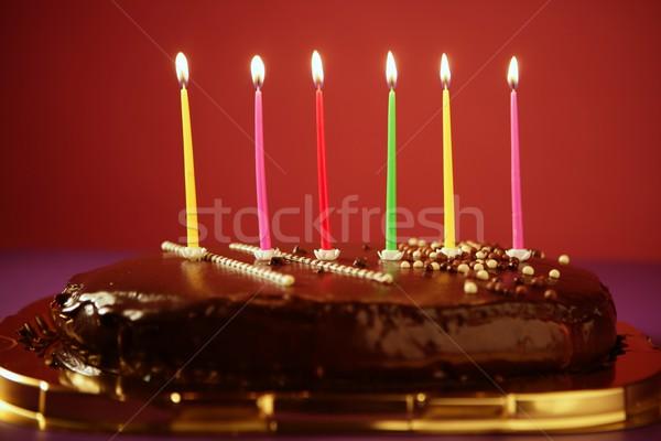 Colorful birthday light candles in chocolate cake Stock photo © lunamarina