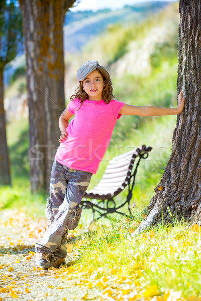 kid girl with camouflage pants and cap in park bench outdoor Stock photo © lunamarina