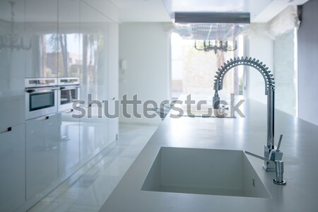 Modern white kitchen perspective with integrated bench Stock photo © lunamarina
