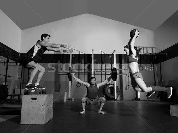 gym group workout barbells slam balls and jump Stock photo © lunamarina