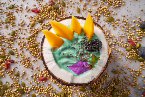 Spirulina bowl smoothie in coconut blackberry mango Stock photo © lunamarina