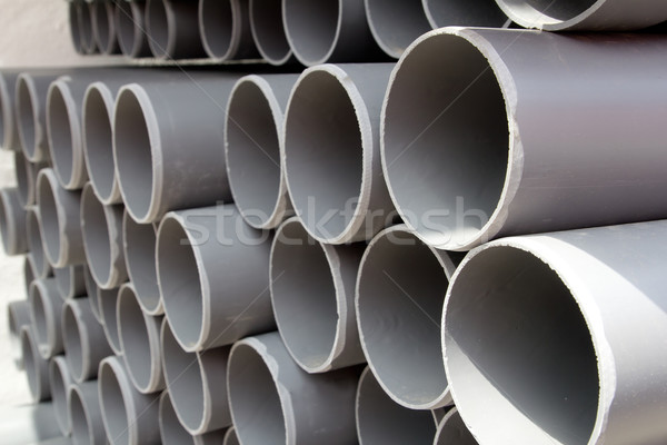 gray PVC tubes plastic pipes stacked in rows Stock photo © lunamarina