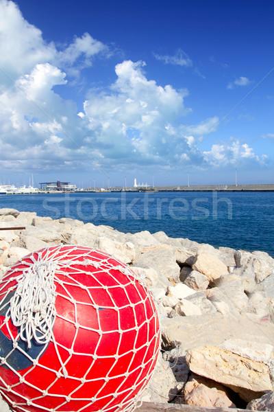 fishing buoy with net in formentera port Stock photo © lunamarina