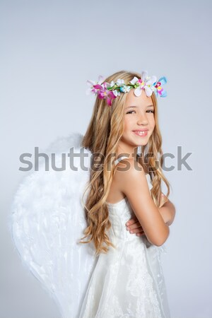 Angel girl in golden field with feather white wings Stock photo © lunamarina