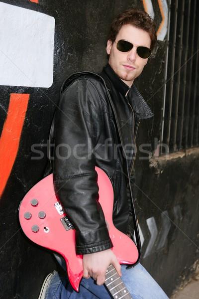 Rock star człowiek czarny graffiti gitara elektryczna Zdjęcia stock © lunamarina
