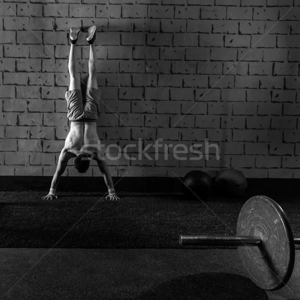 Handstand push-up man workout at gym Stock photo © lunamarina