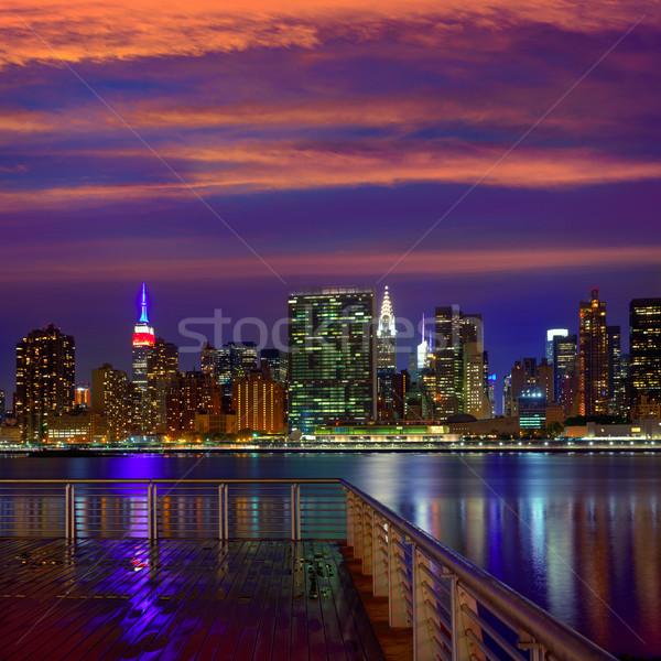 Manhattan Nova Iorque pôr do sol linha do horizonte chuvoso crepúsculo Foto stock © lunamarina