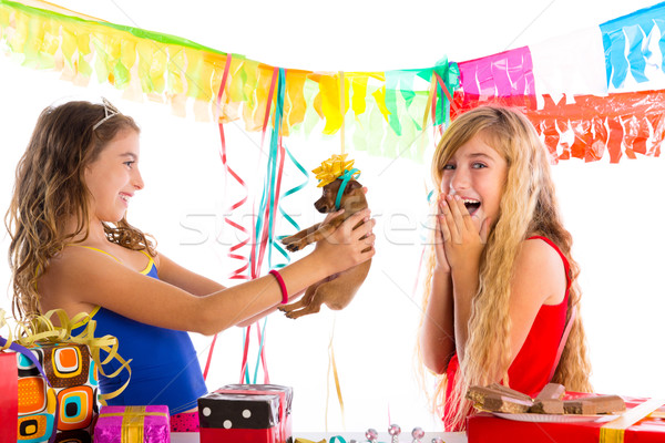 girl friends party excited with puppy dog present Stock photo © lunamarina