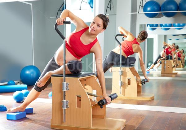 pregnant woman pilates side stretch exercise Stock photo © lunamarina