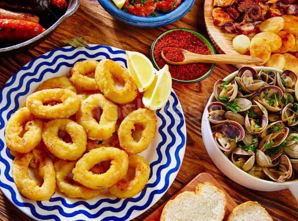 Tapas squid anneaux fruits de mer Espagne pain Photo stock © lunamarina