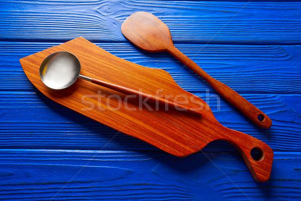 Chef tool wood spatula and table board on blue Stock photo © lunamarina